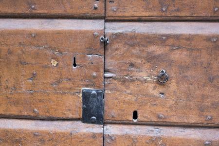 not open: ancient lock in a big wooden door of the medieval castle