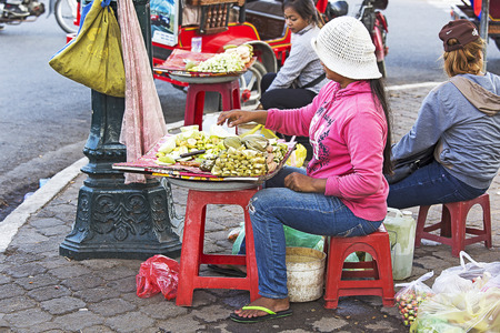 phen: Stock Photo - phnom phen, Cambodia - April 25, 2014: street seller street in Phnom Phen Editorial