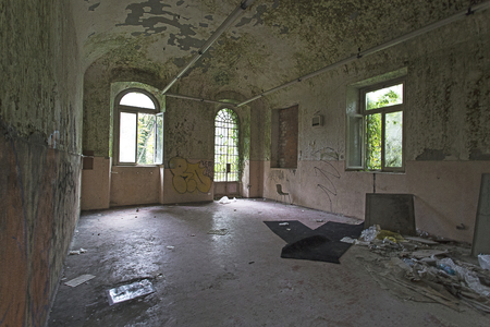 run down: Limbiate, Italy - September 27, 2015: Abandoned Hospital Building called Mombello. The building was abandoned nearly twenty years ago, but never demolished