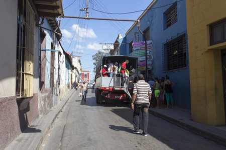 queueing: Camaguay, Cuba - December 29, 2015: Street view in Camaguay, people queueing for public transportation