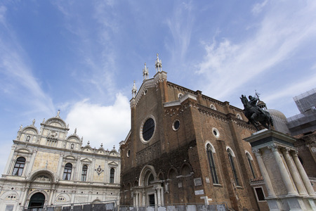 Venice, Italy - May 02, 2015:  low angle view of the Basilica di Santa Maria Gloriosa dei Frari on the square Campo dei Frari Editorial