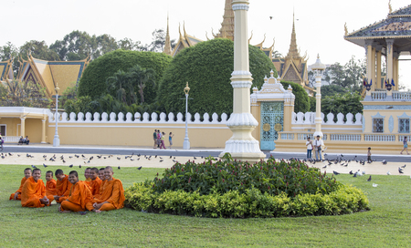 phnom phen: Phnom Penh, Cambodia - April 25, 2014: Monks tour the Royal Palace grounds in Phnom Penh, Cambodia Editorial