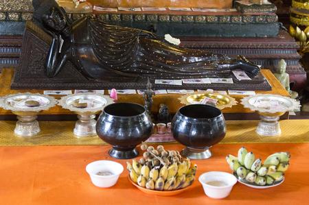 phen: Phnom Phen, Cambodia - April 25, 2014: religious offers in a buddist temple in Cambodia Editorial