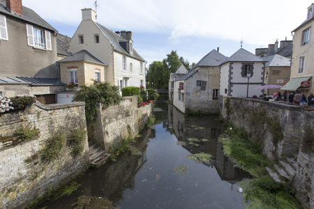 Bayeux, France - August 14, 2016: view of a street of Bayeux, France with a small river