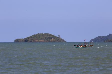 Sihanoukville, Cambodia - April 26, 2014: coatline, islands and tourists boat in Sihanoukville, Cambodia Редакционное