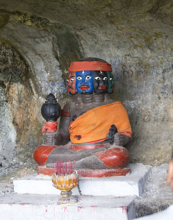Kampot province, Cambodia - April 26, 2014: Coloured Statue in a cave, in Kampot province, Cambodia