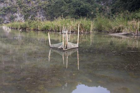 fish trap in a small river, Vietnam