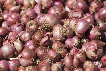 red onions background at market, Asia