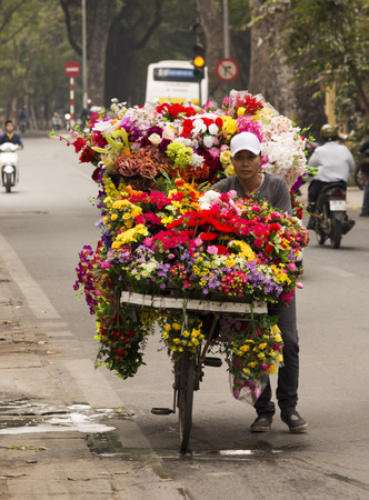 Hanoi, Vientam - January 04, 2017: Typical street vendor in Hanoi, Vietnam