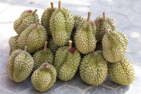 Durian fruits in the street at market Imagens