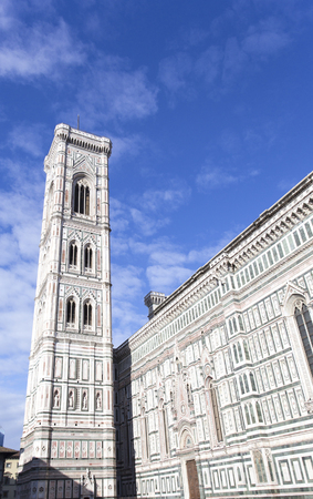 Basilica of Florence and tower in a sunny day, Italy 스톡 콘텐츠