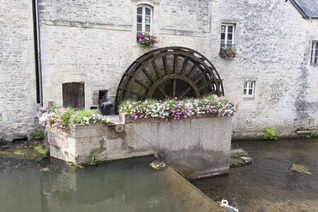 Bayeux, France - August 14, 2016: Water mill and Aure River in the old city of Bayeux in Calvados department in Normandy, France