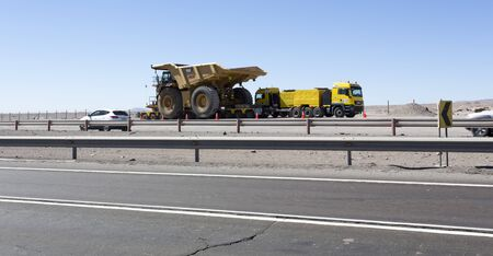 La Serena, Chile - August 23, 2019: a huge mine truck being transported along panamericana road