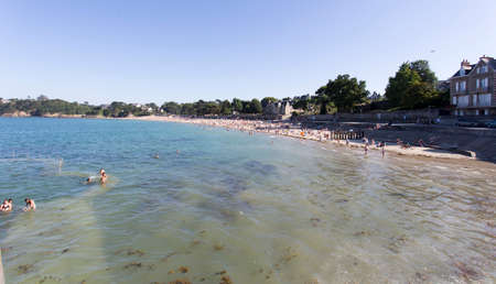 Dinard, France - August 15, 2016: lot of tourists on the beach of Dinard during hot summer