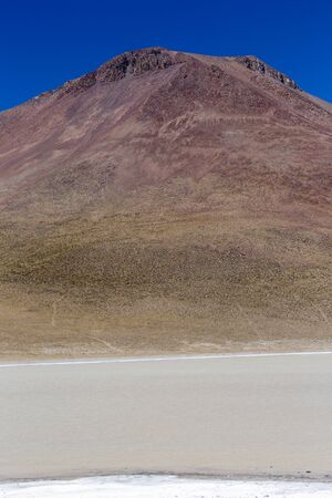 A vertical landscape of lagoon and mountain in Bolivia