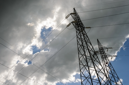 electromagnetism: Pylons in backlight against a cloudy and blue sky  Stock Photo