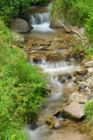 The stream that flows in Vigo di Fassa  photo
