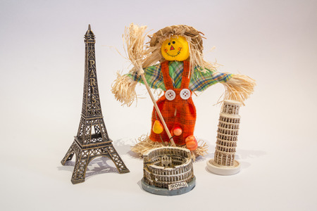 Scarecrow with the towers and the Colosseum photo