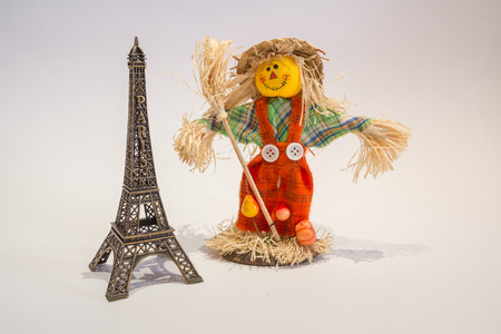 eifel tower: A funny colorful scarecrow with the eifel tower