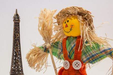 A funny colorful scarecrow with the eifel tower photo
