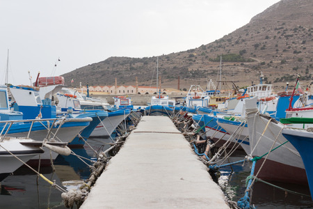 colorful fishing boats moored in the harbor photo