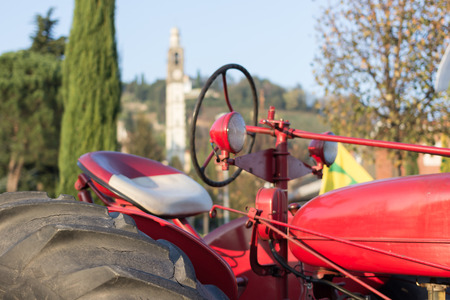 wheel tractor: the workforce of the tractor That helps people in the country for a long time Stock Photo