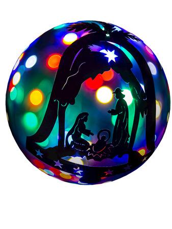 The lights of the Christmas tree balls and symbols of Christmas Nativity
