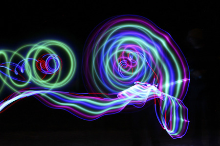 designates: trails of colored light in the dark of night Stock Photo