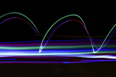 trails of colored light in the dark of night Stock Photo