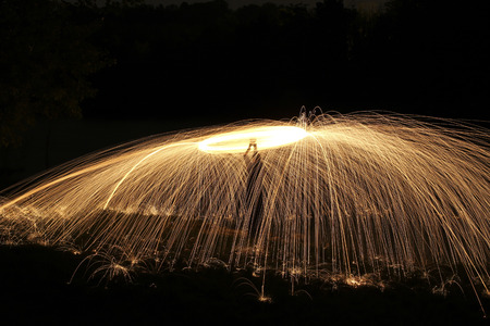 rings of fire and bright sparks light up the night