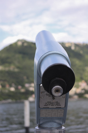 a coin telescope for observing the opposite shore of the lake photo