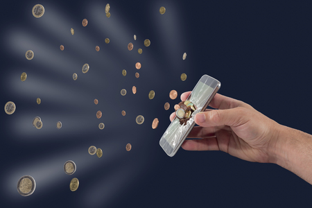 breaks: a smartphone that breaks down and where they exit coins Stock Photo