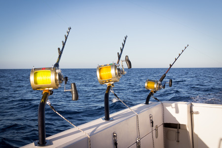sportfishing: fishing rods on a yacht for marlin fishing