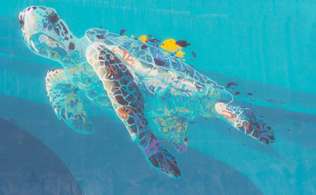 subaquatic: turtle caretta caretta drawn into the clear blue sea Stock Photo