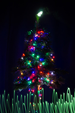 lit: Christmas tree lit up with colored lights Stock Photo