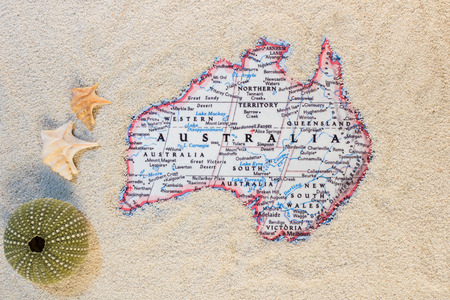 land shell: australia surrounded by sand with sea urchins and shells Stock Photo