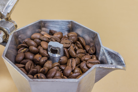 coffeepot: A coffeepot with coffe beans