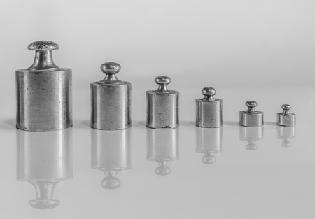 weights for balance of various sizes in a row 写真素材