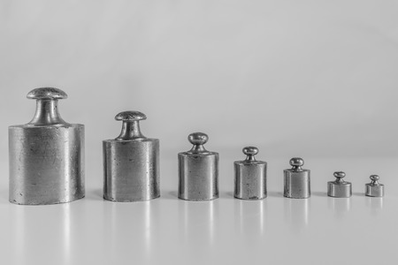 standard steel: weights for balance of various sizes in a row Stock Photo