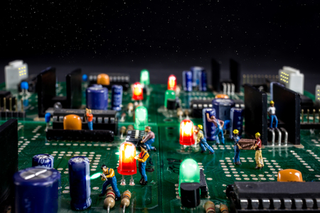 futuristic city: men work on a starry night in a electronic city