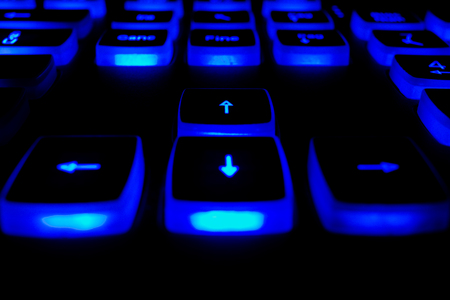 Keyboard with blue light buttons on black background
