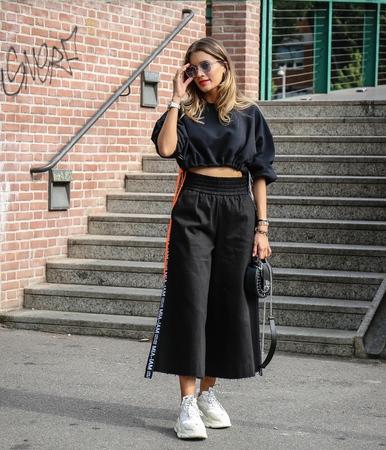 MILAN, Italy- September 19, 2018: Women on the street during the Milan Fashion Week.