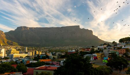 Beautiful view from Bo-Kaap or Malay at sunny day with Table Mountain on background before sunset. The city of Cape Town is a famous travel destinationin Africa. February 2020 Stock Photo