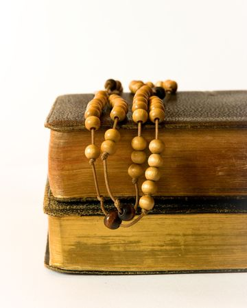 The book of Catholic Church liturgy and rosary beads photo
