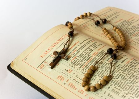 The book of Catholic Church liturgy and rosary beads Stock Photo