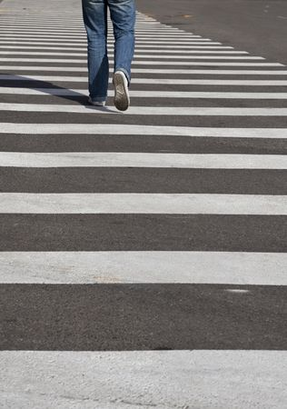 mans legs crossing the street photo