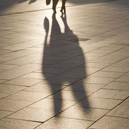 Evening shadows and silhouettes in the square Stock Photo - 7998433