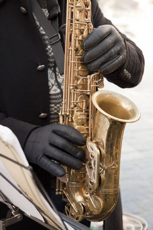 Man playing on the saxophone photo
