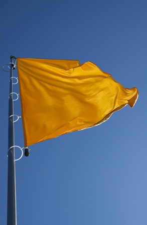 flapping: the flag is flapping in the wind Stock Photo