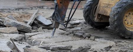 Construction machinery with jackhammer. Demolition work